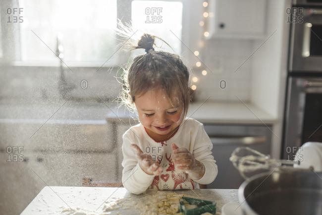 Toddler making Christmas cookies