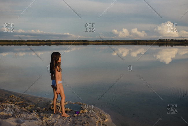 Tween standing by lake in Florida