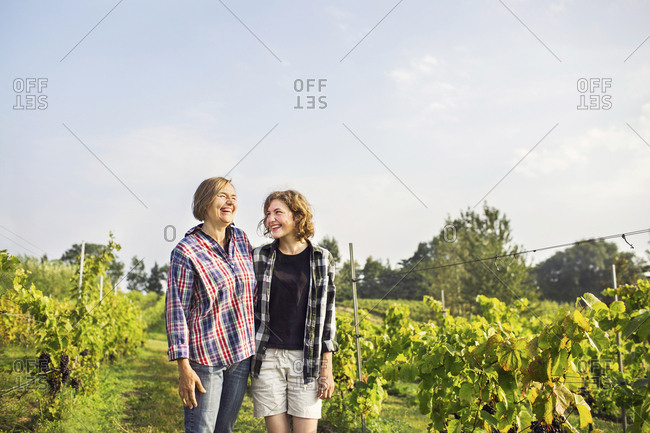 Portrait of mother with daughter in vineyard