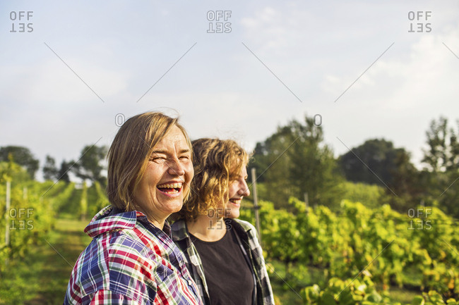 Mother with daughter laughing in vineyard