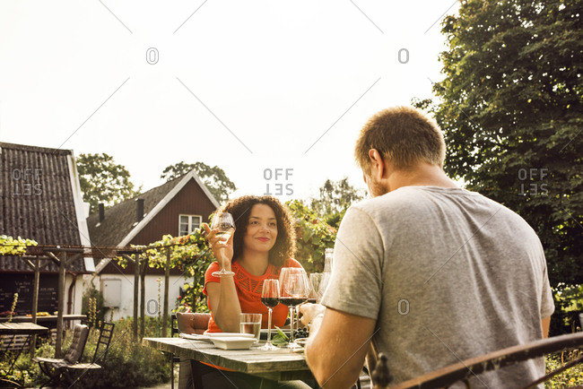 Couple drinking red wine on patio