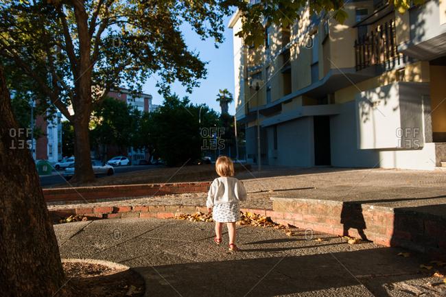Little girl wandering around neighborhood