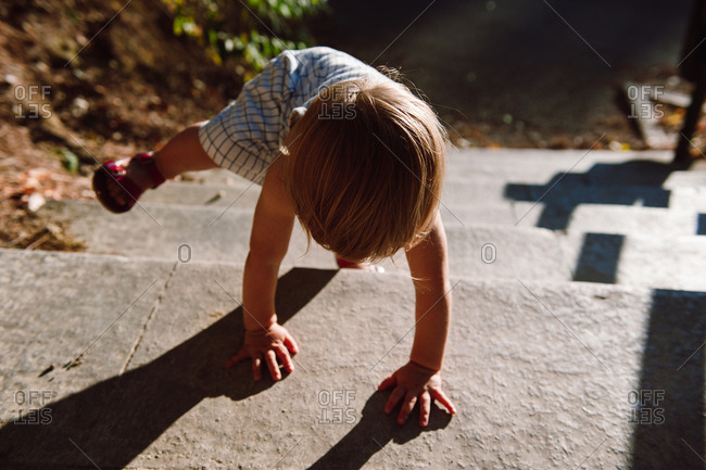 Toddler balancing on outdoor staircase
