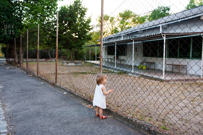 Little girl staring at empty lot