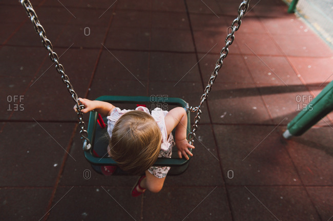 Toddler playing on swing