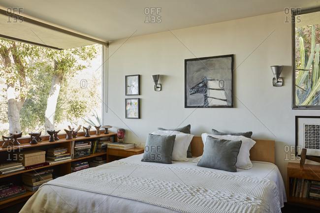 La Crescenta, California - October 24, 2015: Glass wall open view bedroom designed by mid-century architect Richard Neutra