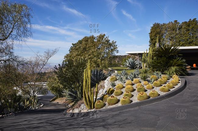 La Crescenta, California - October 24, 2015: Front winding cactus landscaped driveway exterior designed by Richard Neutra