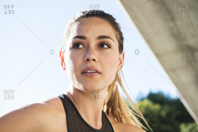 Close-up of thoughtful young woman looking away
