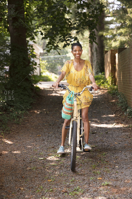 Smiling woman riding bicycle at park
