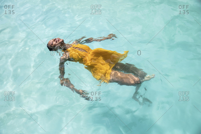 High angle view of woman swimming in pool at tourist resort