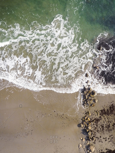High angle scenic view of waves on shore at beach