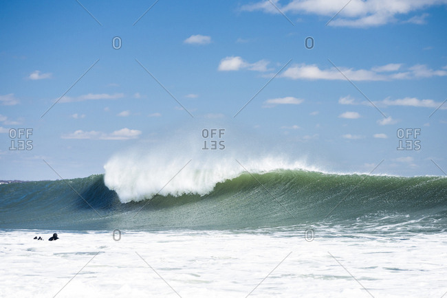 Scenic view of surf splashing in sea against sky