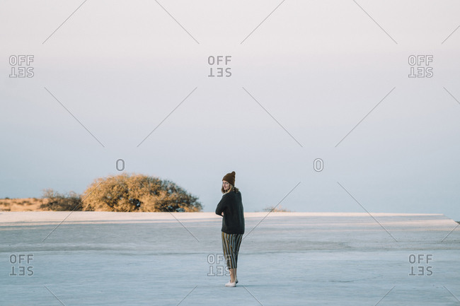 Rear view of woman standing against sea and sky