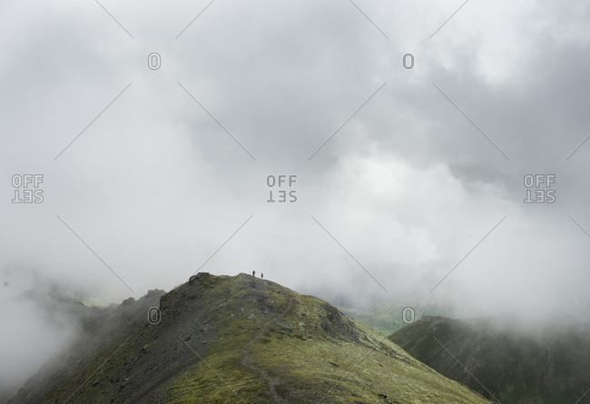 Scenic view of mountain range during foggy weather