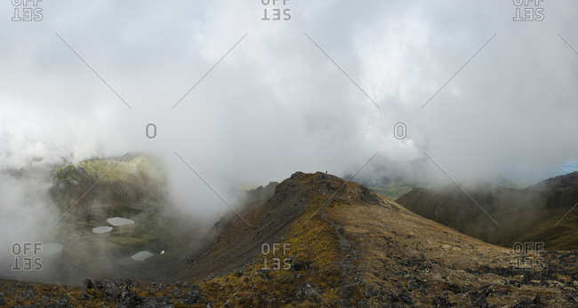 High angle scenic view of landscape during foggy weather