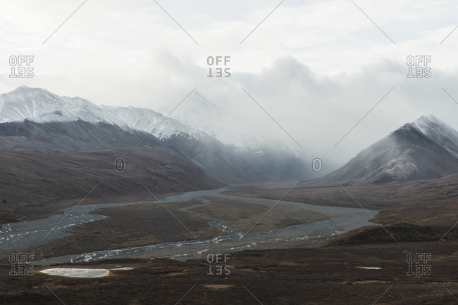 Scenic view of mountain valley at Denali National Park and Preserve during foggy weather