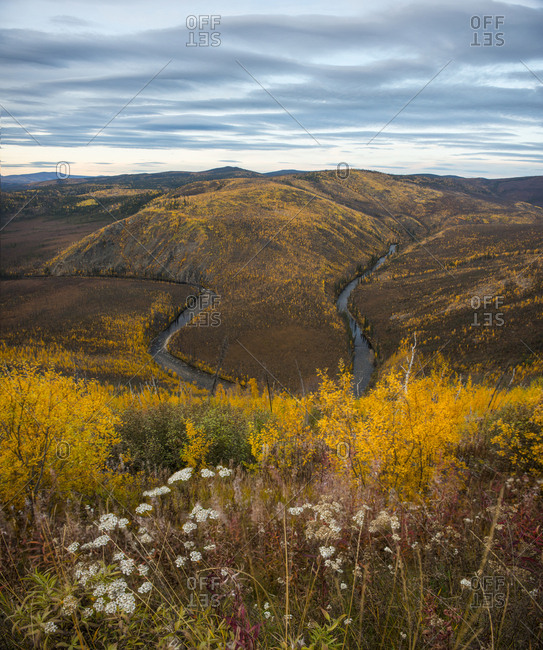 High angle view of river amidst landscape against sky during autumn