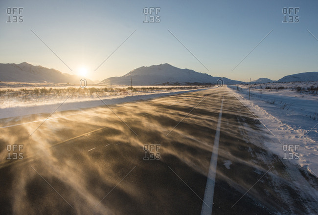 Road against mountains and clear sky during sunrise