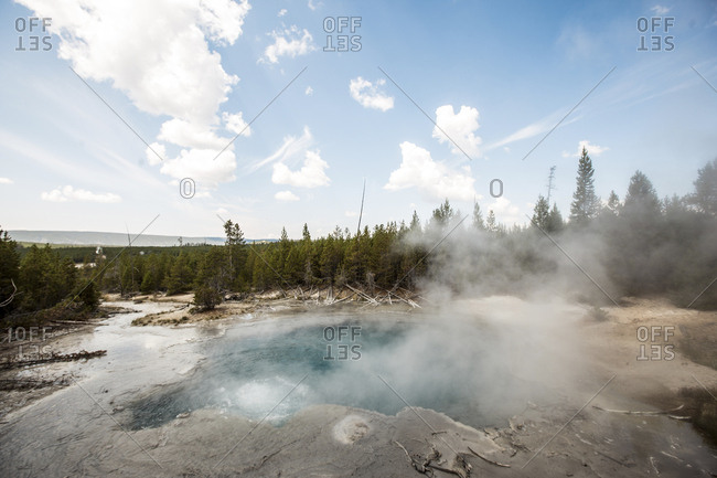 View of hot spring at Yellowstone National Park against sky
