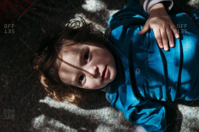 High angle portrait of girl lying on floor
