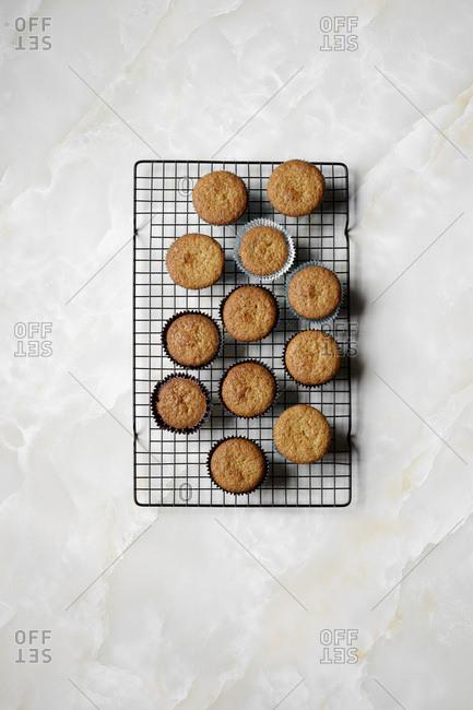 Orange flavor cupcakes cooling on a baking rack