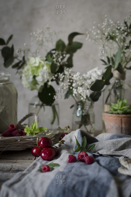 Cherries and flowers on a wooden kitchen table