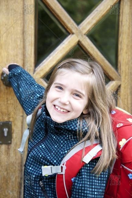 Little schoolgirl with backpack, portrait, Munich, Bavaria, Germany