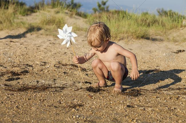 Croatia, Dalmatia, Baby Boy Playing On Sandy Beach