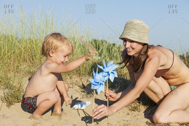 Croatia, Dalmatia, Mother And Son Playing On Beach