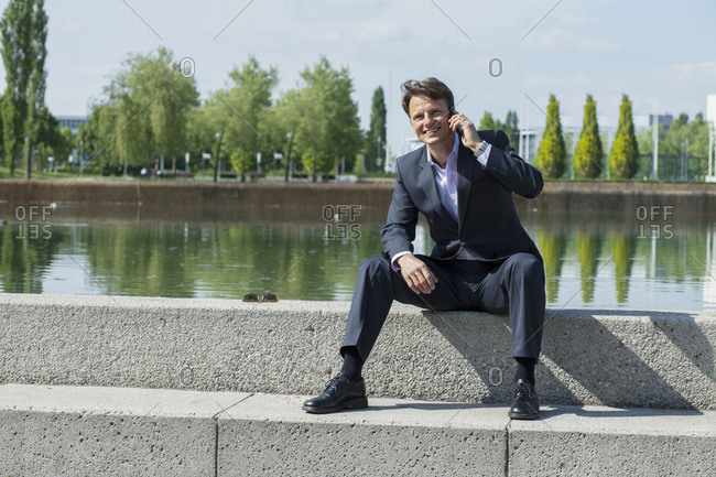Businessman Using Mobile Phone, Munich, Bavaria, Germany