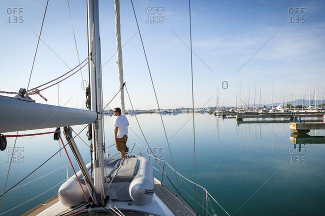 Sailboat entering marina, Adriatic  Sea, Croatia
