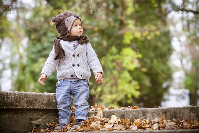 Toddler with cap and scarf in autumn, Osijek, Croatia