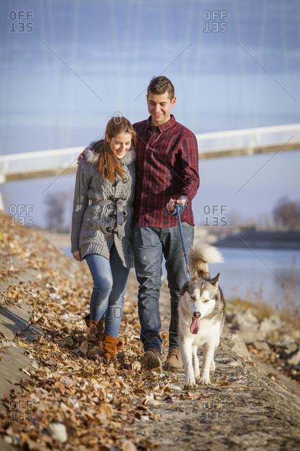 Couple Walking Dog Outdoors, Croatia