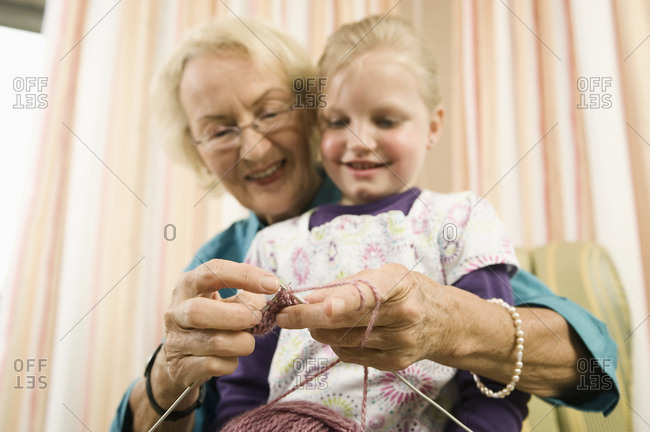 Grandmother teaching granddaughter to knit, Bavaria, Germany