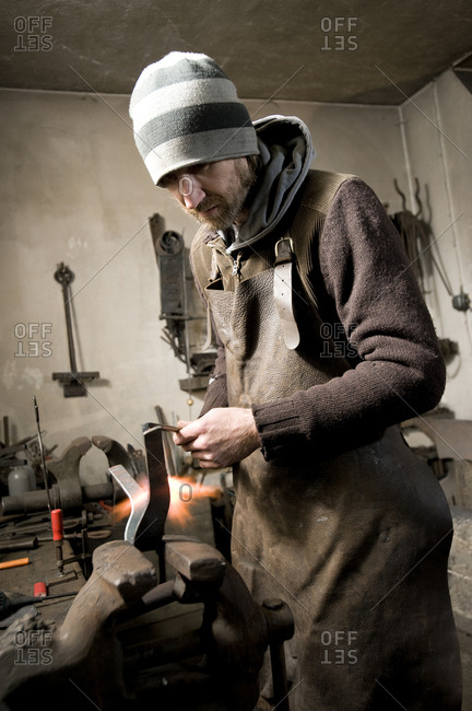 Blacksmith shaping iron, Landshut, Bavaria, Germany
