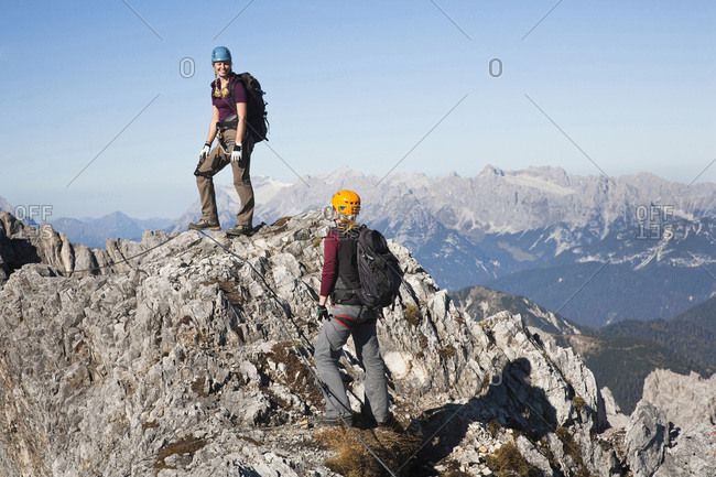 Two female alpinists standing on mountain top, Innsbruck route, Tyrol, Austria