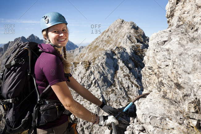 Female alpinist rock climbing, Innsbruck route, Tyrol, Austria