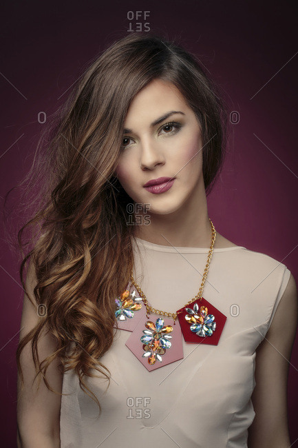 Young woman wearing necklace, portrait