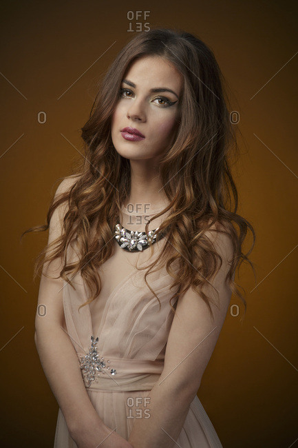 Young woman in evening gown, portrait
