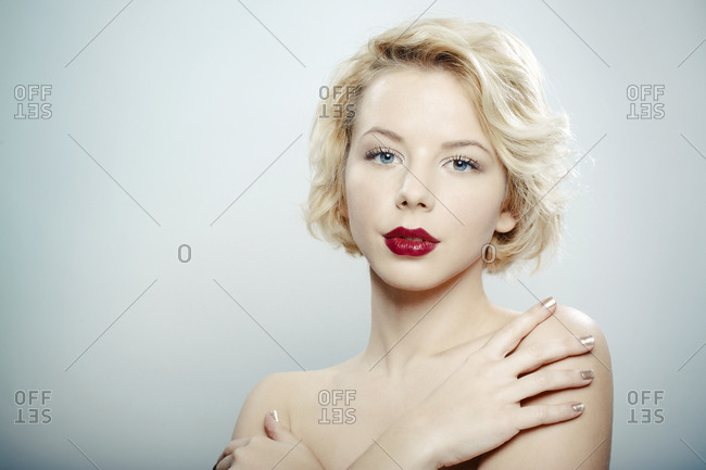 Young woman with red lips, portrait