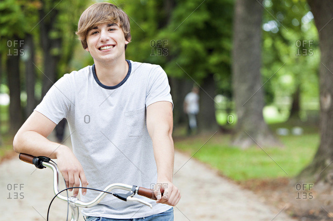 Young man with bicycle in a park, Osijek, Croatia