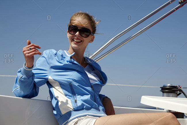 Young woman relaxing on sailboat, Dalmatia, Croatia, Europe