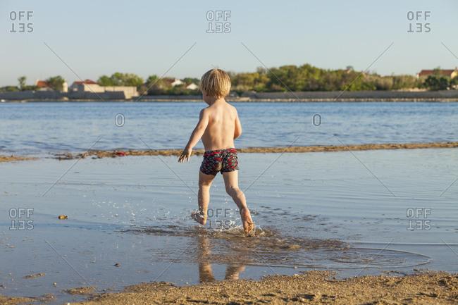 Croatia, Dalmatia, Little Boy Playing on Beach