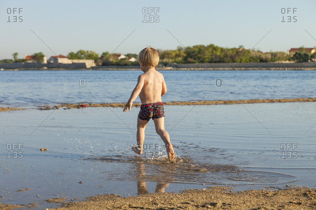 Croatia, Dalmatia, Little Boy Playing on Beach