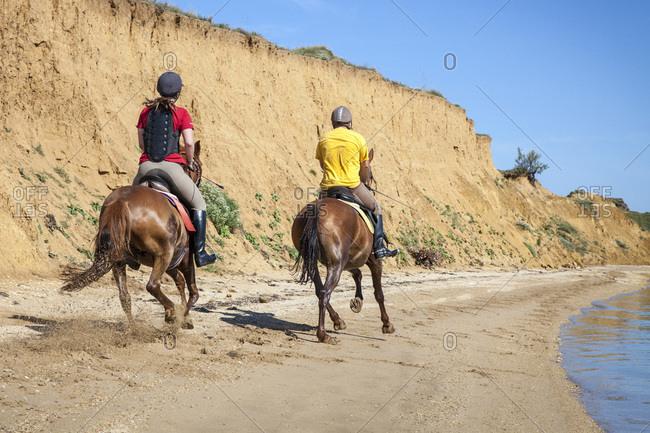 Couple On Sandy Beach Riding Horses, Croatia, Dalmatia, Europe