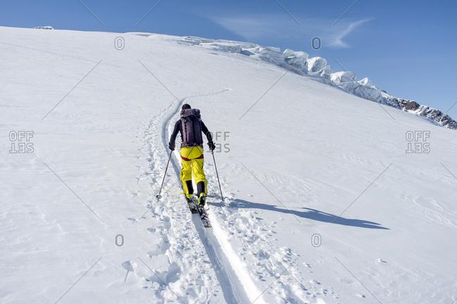 Backcountry skier ploughing through snow, European Alps, Tyrol, Austria