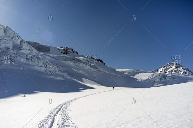 Man back country skiing, European Alps, Tyrol, Austria