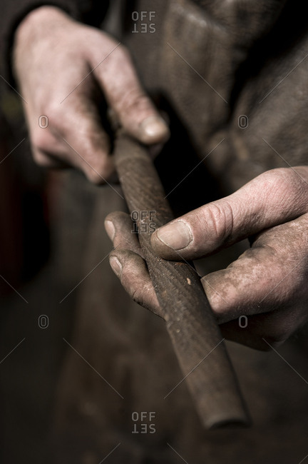 Blacksmith holding Iron Pipe, Landshut, Bavaria, Germany