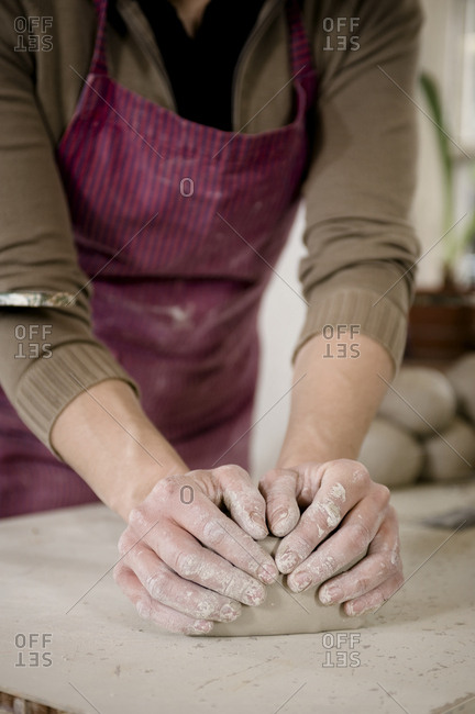 Craftswoman kneading clay, Bavaria, Germany, Europe