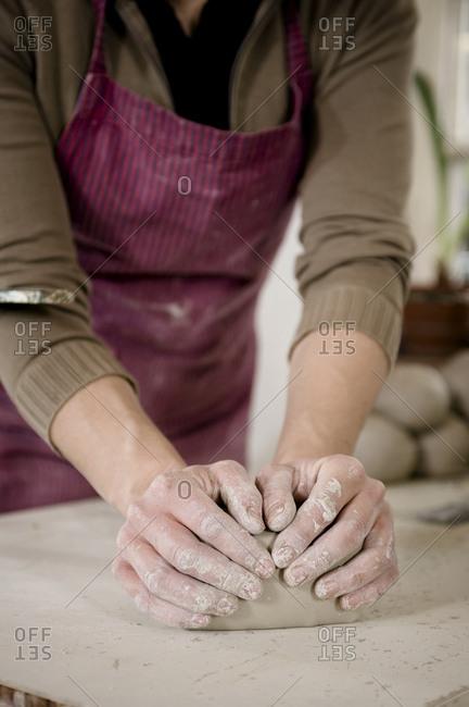 Craftswoman kneading clay, Bavaria, Germany, Europe